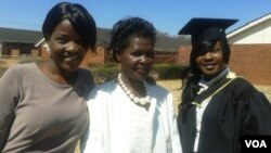 FILE: One of the capped graduands with relatives and friends at Chinhoyi University. (Phot: Arthur Chigoriwa)