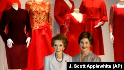 """Happy Heart Syndrome"" affects mostly women. Little is known about the disease. Pictured here are First Ladies Nancy Regan and Laura Bush in 2005. They raised awareness about women and heart disease with a national campaign featuring red dresses worn by First Ladies throughout history. (AP Photo/J. Scott Applewhite)"