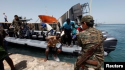 Illegal migrants arrive at a naval base after they were rescued by Libyan coastguard in the coastal city of Tripoli, Libya, May 6, 2017.