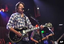FILE - John Fogerty performs on his 68th birthday at the El Rey Theatre in Los Angeles, May, 28, 2013.
