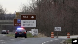 A Maryland State Police cruiser sits at a blocked southbound entrance on the Baltimore-Washington Parkway that accesses the National Security Agency, March 30, 2015, in Fort Meade, Md.