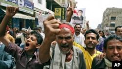 Anti-government protestors shout slogans during a demonstration demanding the resignation of Yemeni President Ali Abdullah Saleh, in Taiz, Yemen, Sunday, June 19, 2011.