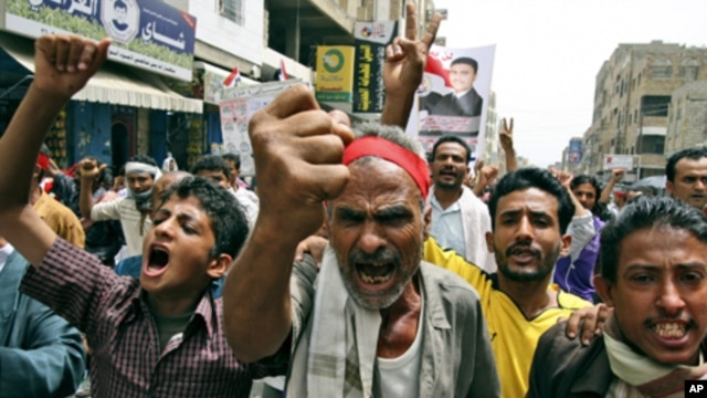 Anti-government protestors shout slogans during a demonstration demanding the resignation of Yemeni President Ali Abdullah Saleh, in Taiz, Yemen, Sunday, June 19, 2011.