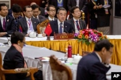 China's Foreign Minister Wang Yi, center back, attends the Special ASEAN-China Foreign Ministers' meeting on the Novel Coronavirus Pneumonia in Vientiane, Laos, Thursday, Feb. 20, 2020.