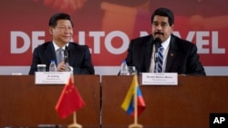 習近平(左)和委內瑞拉總統馬杜羅(右)