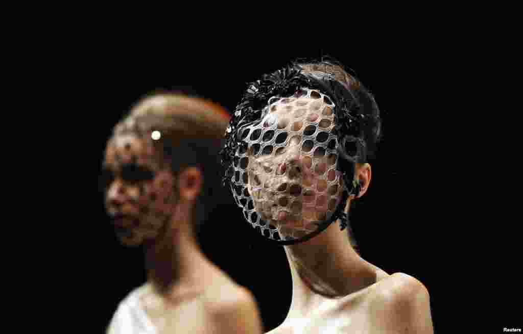 Models present creations by Aurelio Costarella during Fashion Week Australia in Sydney. Fashion Week Australia runs until April 12.