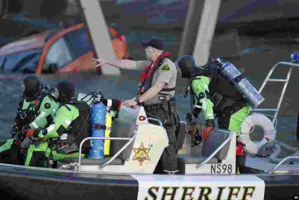 A rescue boat and divers search near the collapsed Interstate 5 bridge, Mount Vernon, Washington, May 23, 2013.