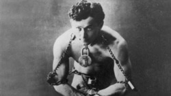 Legendary escape artist Harry Houdini is shown in chains in this photo circa 1899.