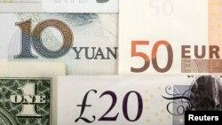 Ilustrasi mata uang dunia termasuk yuan, dolar Amerika, euro dan pound.