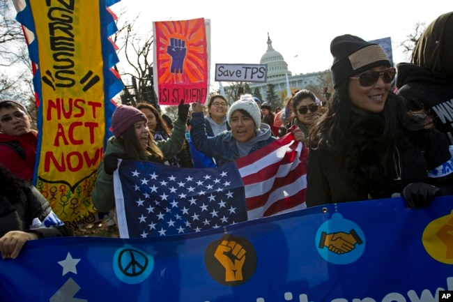 FILE - Demonstrators march during an immigration rally in support of the Deferred Action for Childhood Arrivals (DACA), and Temporary Protected Status (TPS), programs, on Capitol Hill in Washington, Dec. 6, 2017.