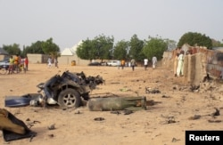 FILE - Damage is seen following an attack by Boko Haram militants in the northeast city of Maiduguri, Nigeria, April 27, 2018.