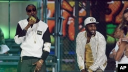 Snoop Dogg, left, and Jason Derulo perform on stage at the Billboard Music Awards at the MGM Grand Garden Arena on May 18, 2014, in Las Vegas.