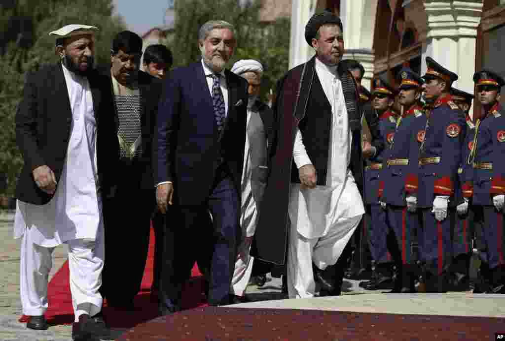 Chief Executive Abdullah Abdullah (center) arrives for an inauguration ceremony at the presidential palace in Kabul, Sept. 29, 2014.