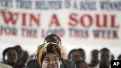 Liberian President Ellen Johnson Sirleaf attends a church service at the Dominion Christian Fellowship Center, in Monrovia, Liberia, November 6, 2011.