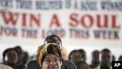 Liberian President Ellen Johnson Sirleaf attends a church service at the Dominion Christian Fellowship Center, in Monrovia, Liberia, November 6, 2011.