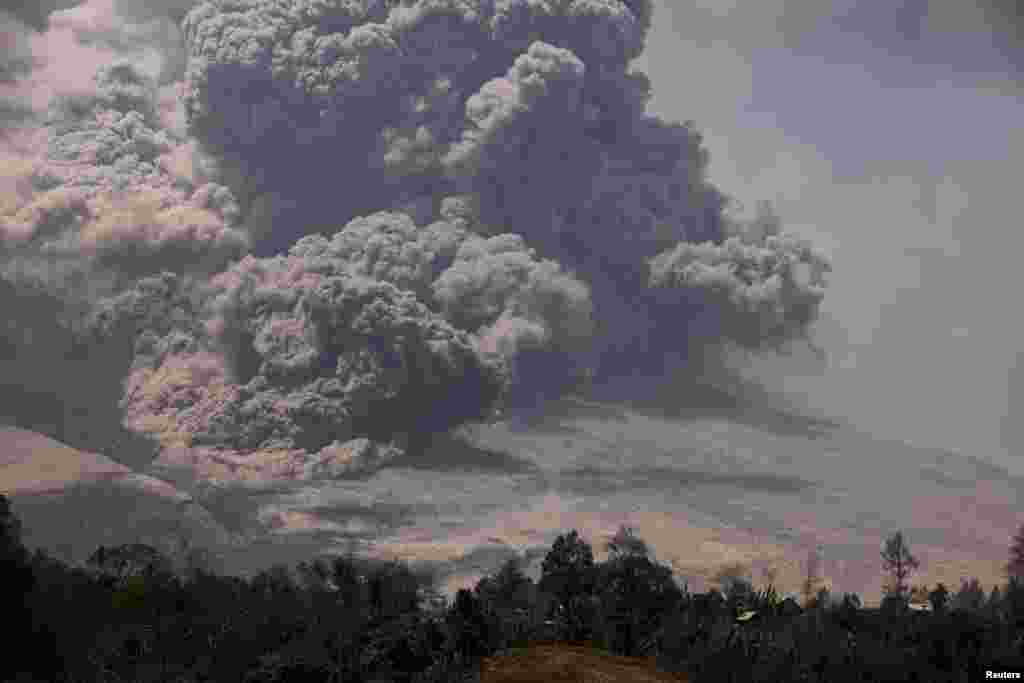 Mount Sinabung spews ash as seen from Payung village in Karo district, North Sumatra province, Indonesia, Feb. 3, 2014.