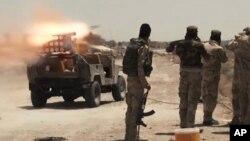 Pasukan Irak dan milisi Syiah melakukan serangan roket terhadap sasaran ISIS di dekat kota Fallujah (foto: dok). Irak sepakat berbagi intelijen dengan 3 negara dalam memerangi ISIS.