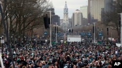 Fans line Benjamin Franklin Parkway before a Super Bowl victory parade for the Philadelphia Eagles football team, Feb. 8, 2018, in Philadelphia.
