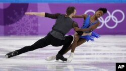 Vanessa James and Morgan Cipres of France perform in the pair skating short program team event at the 2018 Winter Olympics in Gangneung, South Korea, Feb. 9, 2018.