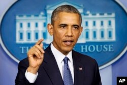 President Barack Obama speaks in the Brady Press Briefing Room of the White House in Washington, Aug. 1, 2014.