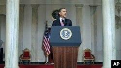 President Barack Obama makes a statement on the resignation of Egypt's President Hosni Mubarak in the Grand Foyer at the White House in Washington, February 11, 2011