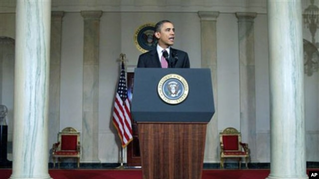 President Barack Obama makes a statement on the resignation of Egypt's President Hosni Mubarak in the Grand Foyer at the White House in Washington, February 11, 2011
