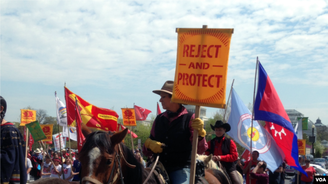Native Americans, farmers, ranchers and cowboys gather outside the Capitol Hill during a 'Reject and Protect' rally to protest against the Keystone XL tar sands pipeline, Washington, D.C., April 22, 2014. (Diaa Bekheet/VOA)