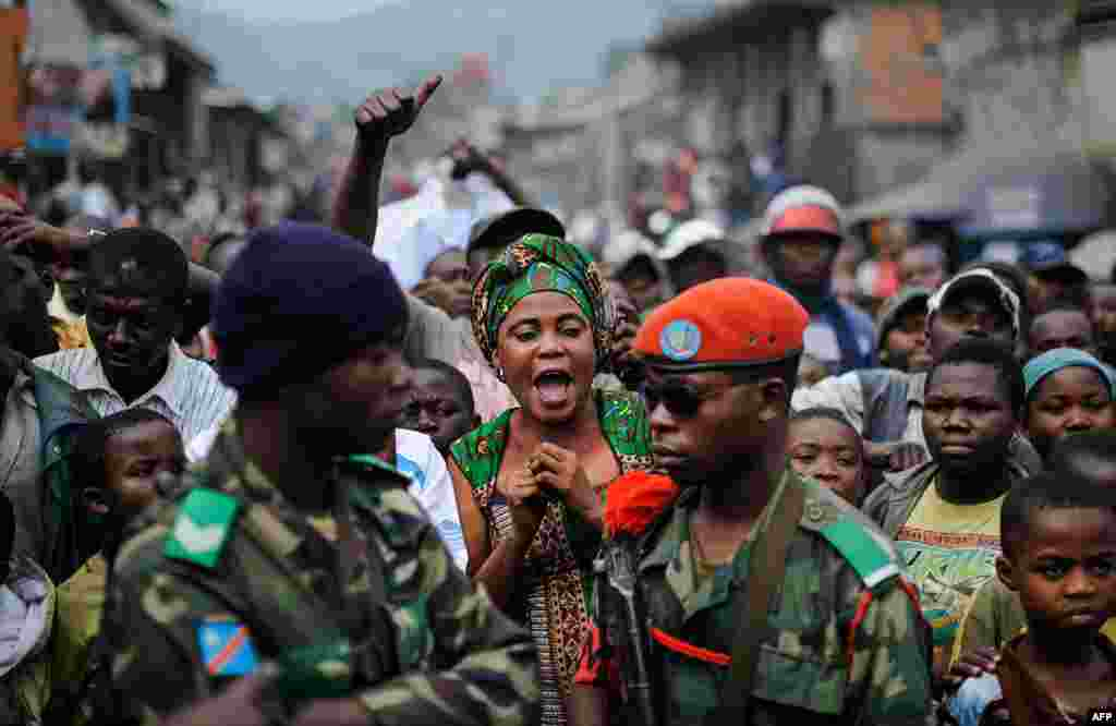 A woman reacts to the arrival of Colonel Mamadou, commander of the 42nd battalion of the Congolese armed forces (FARDC), as he tries to disperse a demonstration in Goma in the east of the Democratic Republic of the Congo.