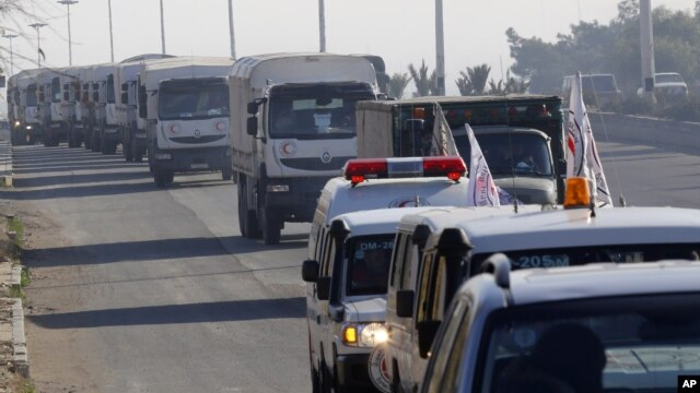 FILE - A convoy of trucks loaded with humanitarian supplies heads to the besieged town of Madaya, 24 kilometers southwest of Damascus, Syria, Jan. 14, 2016.