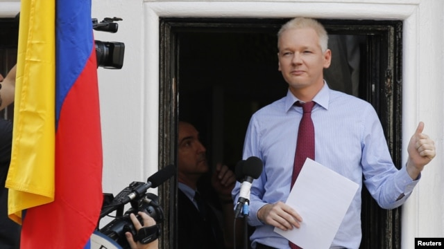 Wikileaks founder Julian Assange appears to speak from the balcony of Ecuador's embassy, where he is taking refuge in London, August 19, 2012.