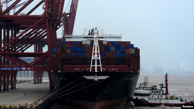FILE - A cargo ship is anchored at a port in Zhoushan, Zhejiang province, Feb. 14, 2016. China's exports fell 11.2 percent in January from a year earlier and imports tumbled 18.8 percent.
