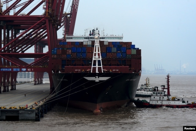 FILE - bA cargo ship is anchored at a port in Zhoushan, Zhejiang province, Feb. 14, 2016. China's exports fell 11.2 percent in January from a year earlier and imports tumbled 18.8 percent.