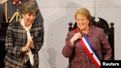 Chile's President Michelle Bachelet smiles next to Senate President Isabel Allende (L), daughter of late former President Salvador Allende, after delivering her annual address at the national congress building in Valparaiso city, northwest of Santiago, Ma