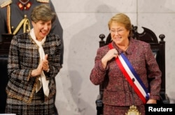Chile's President Michelle Bachelet smiles next to Senate President Isabel Allende (L), daughter of late former President Salvador Allende.