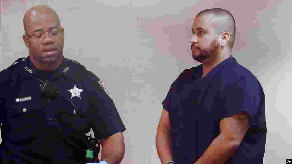 George Zimmerman, à droite, lors de sa première apparition au palais de justice en Floride, le 10 janvier 2015.