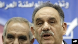 In this February. 25, 2010 file photo, Iraq's Deputy Prime Minister Saleh al-Mutlaq, right, speaks to reporters in Baghdad, Iraq.