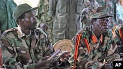 Leader of the Lord's Resistance Army, Joseph Kony, (L) and his deputy Vincent Otti in Ri-Kwamba, Southern Sudan (File)