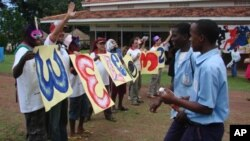 Justin Silbaugh (second from left in cap) and staffers welcome arriving students to art camp in Uganda.