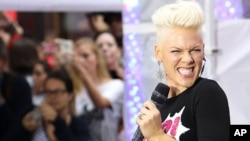 "This image released by Starpix shows singer Pink performing during an appearance on the ""Today"" show, Sept. 18, 2012 in New York. Pink was promoting her new album, ""The Truth About Love."""