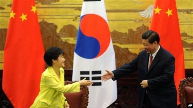 FILE - South Korean President Park Geun-hye, left, and Chinese President Xi Jinping, Great Hall of the People, Beijing, June 27, 2013.