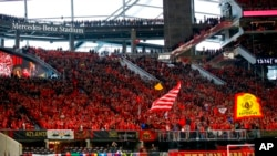 FILE - In this March 11, 2018, photo, fans wait for an MLS soccer match between D.C. United and Atlanta United in Atlanta.