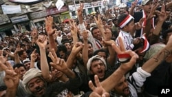 Yemeni anti-government protesters shout slogans during a demonstration demanding the resignation of President Ali Abdullah Saleh in Sana'a, April 28, 2011