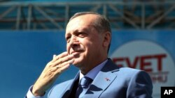 FILE - Turkey's President Recep Tayyip Erdogan gestures as he addresses his supporters during a referendum rally in Sanliurfa, Turkey, April 11, 2017.