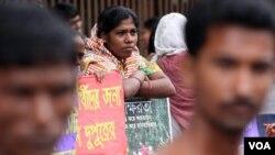 File - Bangladeshis participate in a rally marking International Literacy Day, in Dhaka, Bangladesh.