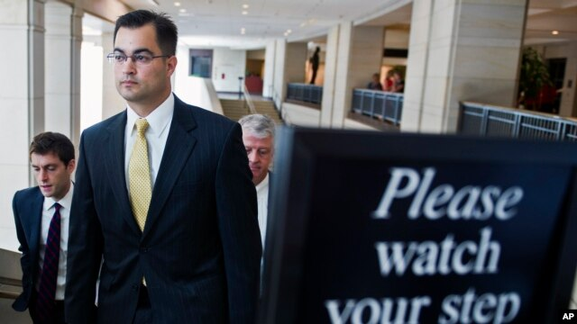FILE - Bryan Pagliano, a former State Department employee who helped set up and maintain a private email server used by Hillary Rodham Clinton, departs Capitol Hill, Sept. 10, 2015.
