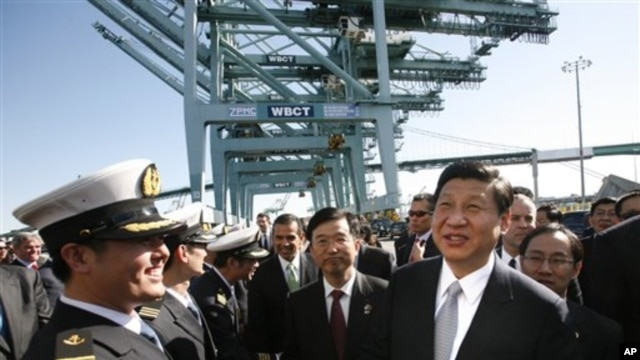 Chinese Vice President Xi Jinping , right, shakes hands with officers as he tours China Shipping at the Port Of Los Angeles in San Pedro, Calif. on  Feb. 16, 2012.