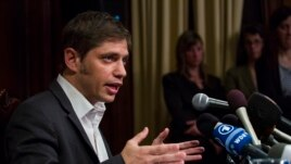 Axel Kicillof, Argentina's economy minister, addresses member of the news media after a negotiation session at the Argentinean Consulate in New York, July 30, 2014.