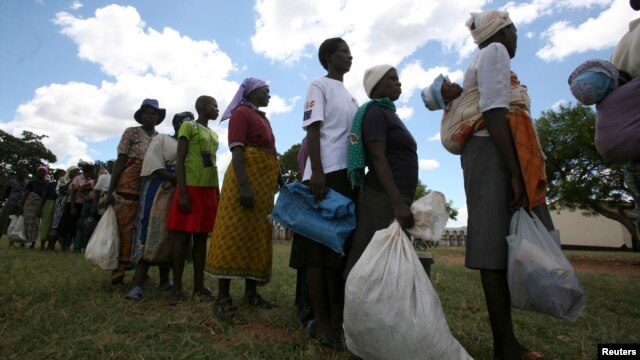Zimbabwean villagers collect monthly food rations from Rutaura Primary School, Mt. Darwin, 254km north of Harare, March 7, 2013.