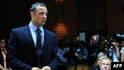 South African Olympic sprinter Oscar Pistorius appears at the Magistrate Court in Pretoria on February 22, 2013.
