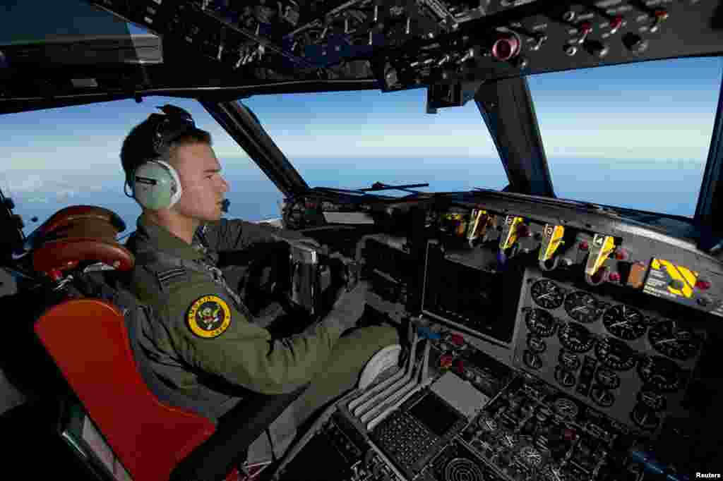 A Royal Australian Air Force pilot steers his AP-3C Orion over the southern Indian Ocean during the search for missing Malaysia Airlines flight MH370 in this picture released by the Australian Defense Force, March 20, 2014.